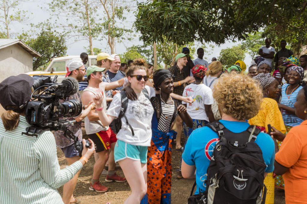 The community at Upper Tambaka, Sierra Leone, singing and dancing to welcome us